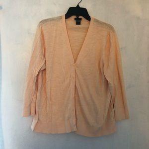 Peach colored cardigan